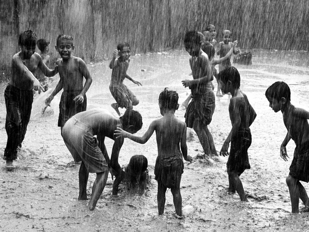 children-play-rain-india_18731_990x742.jpg